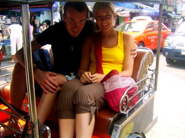 A tuk tuk rides in the busy streets of Bangkok, Thailand