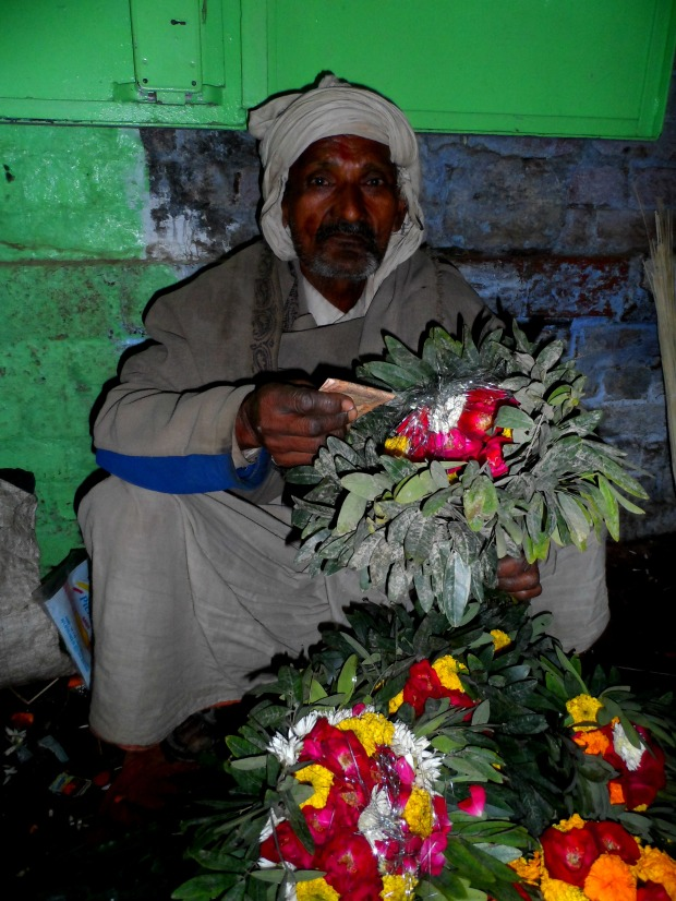 The flower seller happily let me take a photo of him after we gave him some money