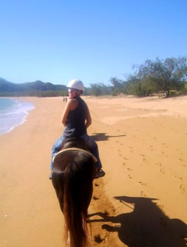 Horse riding along the beach in Magnetic Island, Australia
