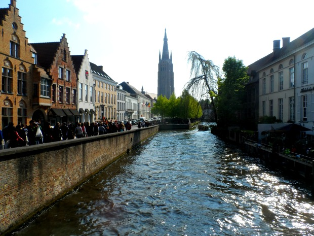 The Church of Our Lady standing tall over Bruges's canals