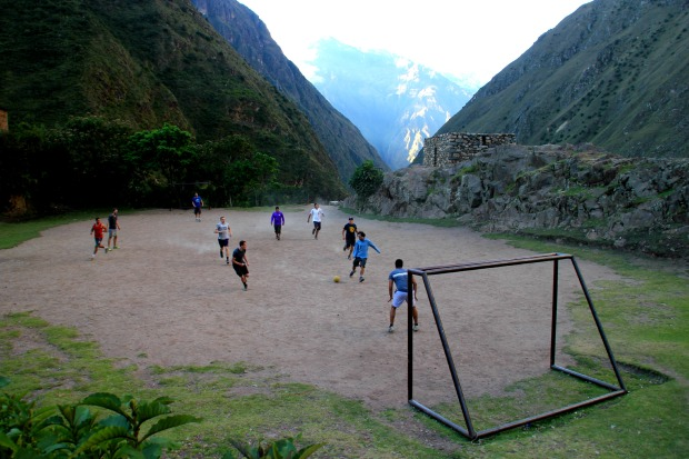 Playing football with the porters up in the mountains on the Inca Trail