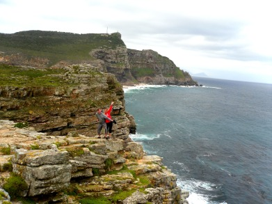 Standing on the edge of the Cape Point, South Africa