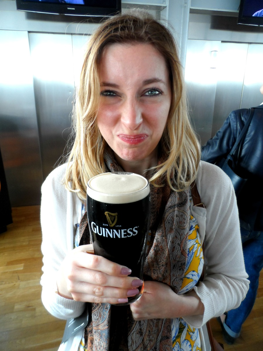 Trying my first sip of Guiness in Dublin